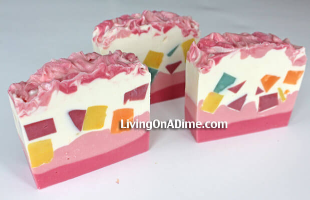 This homemade soap is my quilt soap. I had several pieces of colored lye soap leftover that I cut into pieces. Then I put the pink layers on the bottom and mixed the embeds into the white and poured it on top after the bottom layer of lye soap had set. The put some pink on top and mixed it in for pretty glittery top.