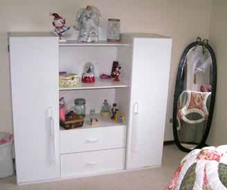 A Dresser along with a free standing mirror