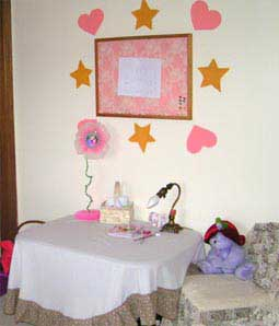I created a craft area with a table for her to do crafts, a fancy chair and a corkbpard to display her art.