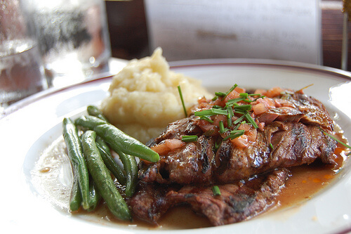 Delicious homemade Swiss steak, garlic green beans