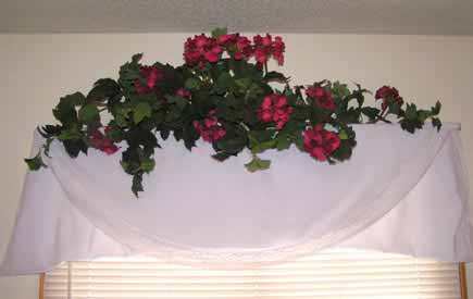 I used a tablecloth with some flowers for a curtain like window dressing