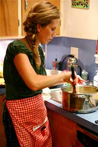 lady cooking and cleaning dinner