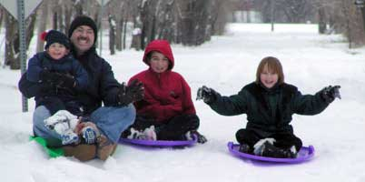 snow sledding with the kids