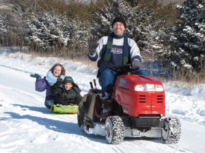 sledding behind a lawn tractor mower