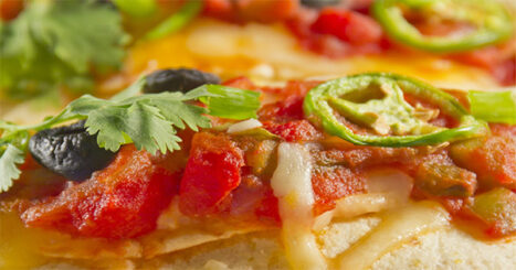 This easy homemade stacked enchiladas recipe makes a quick and easy meal that's great for families! Our entire family loves it, including the kids!